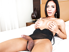 Beautiful Asian shemale strokes her massive cock until she cums.