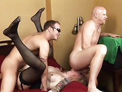 Tattooed shemale beeing banged by 2 massive and aroused cocks