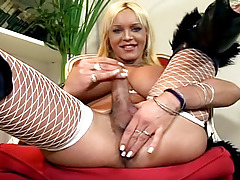 Blonde shemale with huge boobs jerking off her aroused dick